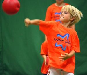 boy punching a ball
